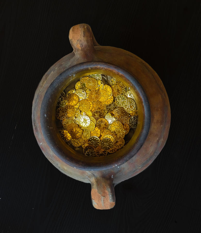 Fake gold and silver coins in earthenware jar. Fake Ottoman gold and silver coins in earthenware jar royalty free stock images