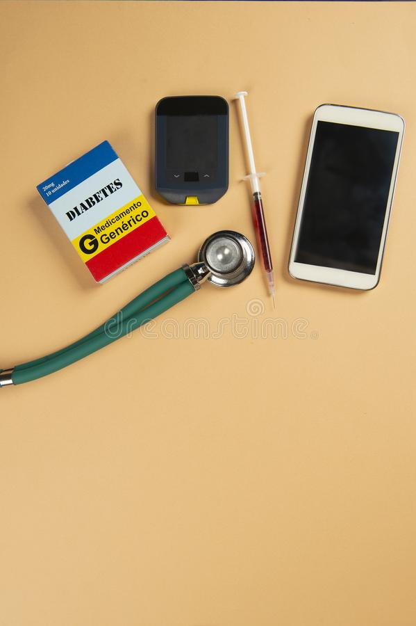 Fake medicine box with the name of the disease Diabetes and a glucometer stock photography