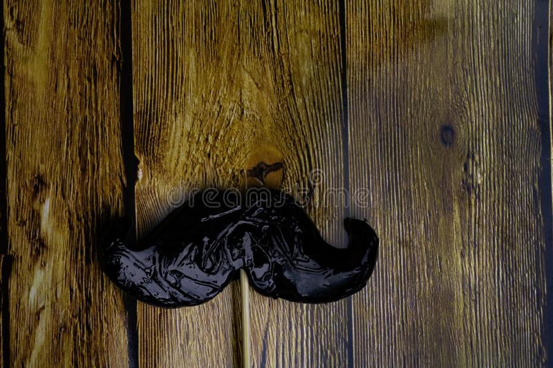 Fake moustache on a wooden background.. Photo props mustaches. men day, Birthday and Party Set and wedding. Flat lay, top view, co stock photos