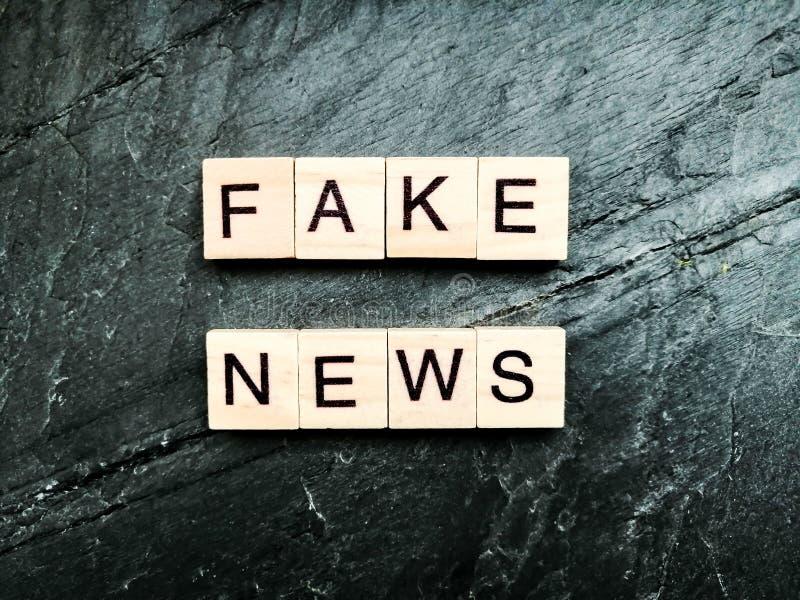 Fake news on grey background stock image