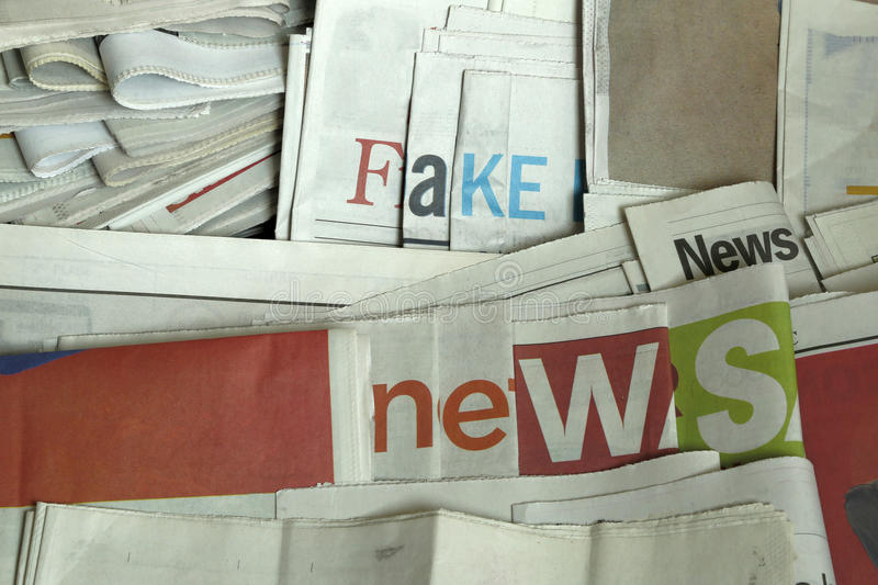 Fake news on newspapers. Some newspapers arranged to display `Fake news stock photography