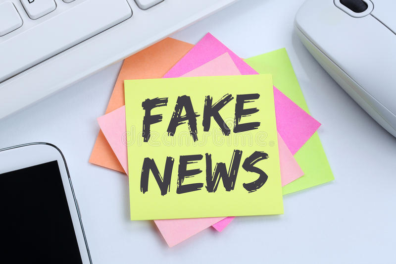Fake news truth lie media internet online office desk. Computer royalty free stock photography