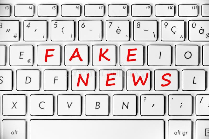 Fake news written on a computer keyboard. Background stock illustration