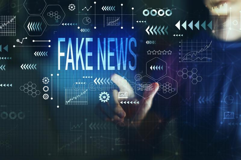 Fake news with young man. On a dark background royalty free stock image