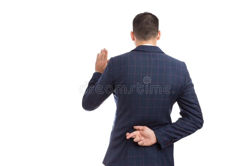 Fake oath vow gesture with fingers crossed behind back. Made by lawyer banker, broker or financial marketing manager royalty free stock photo