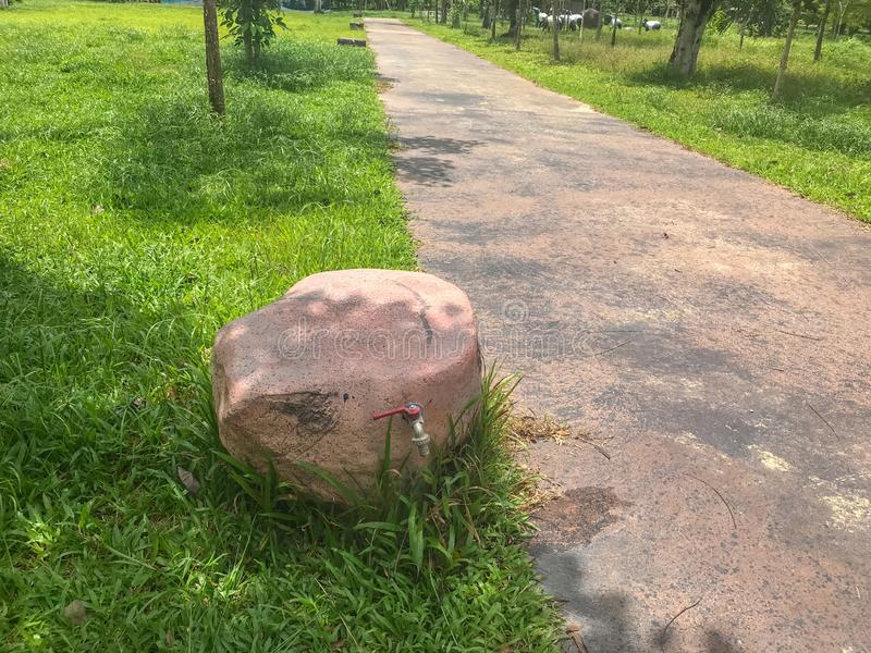 Fake stone faucet at national park at Phatthalung, Thailandgranite, countertop, backsplash, empty, nobody, decoration. Close up of fake stone faucet at national stock photography
