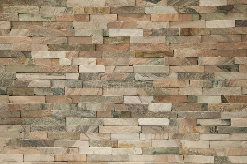 Fake stone wall brick background wallpaper. Fake stone brick wall facade inside apartment interior creating background wallpaper stock images