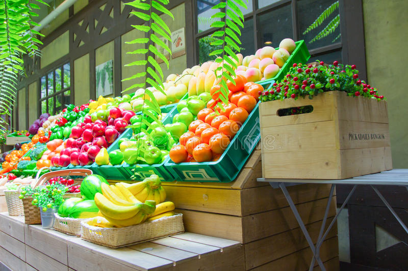 Fake vegetables and fruits on shelves stock photo