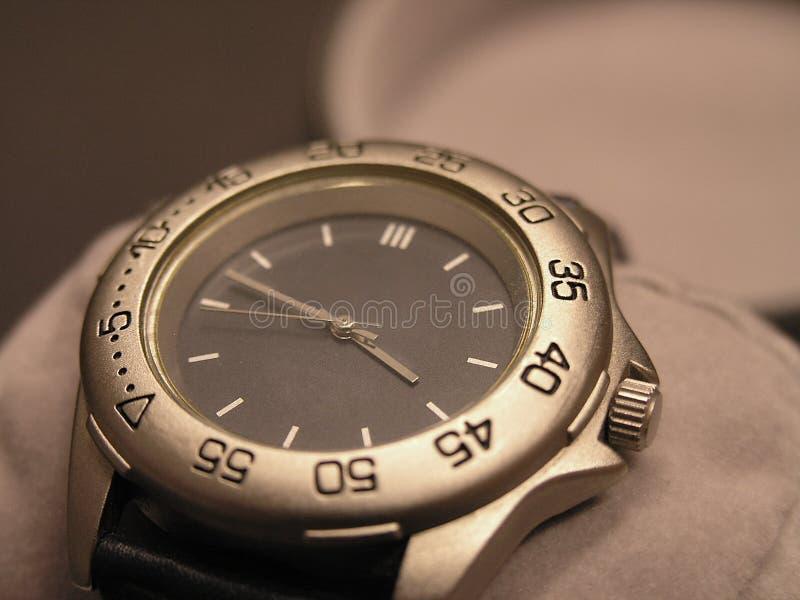 Fake watch. Fake titan wristwatch on supportive cushion royalty free stock photos
