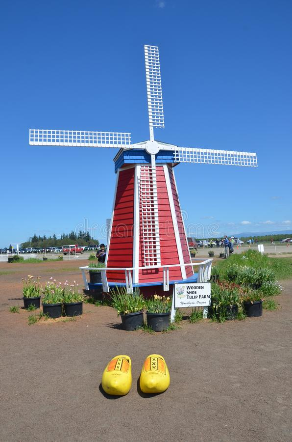 Windmill on Tulip Farm. This is a fake windmill on the Wooden Shoe Tulip Farm near Woodburn Oregon with a pair of yellow wooden shoes royalty free stock photography