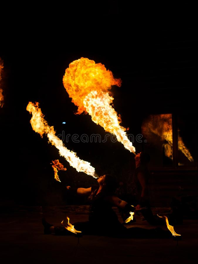 Fakirs blow fire at fire show performance in the night royalty free stock image