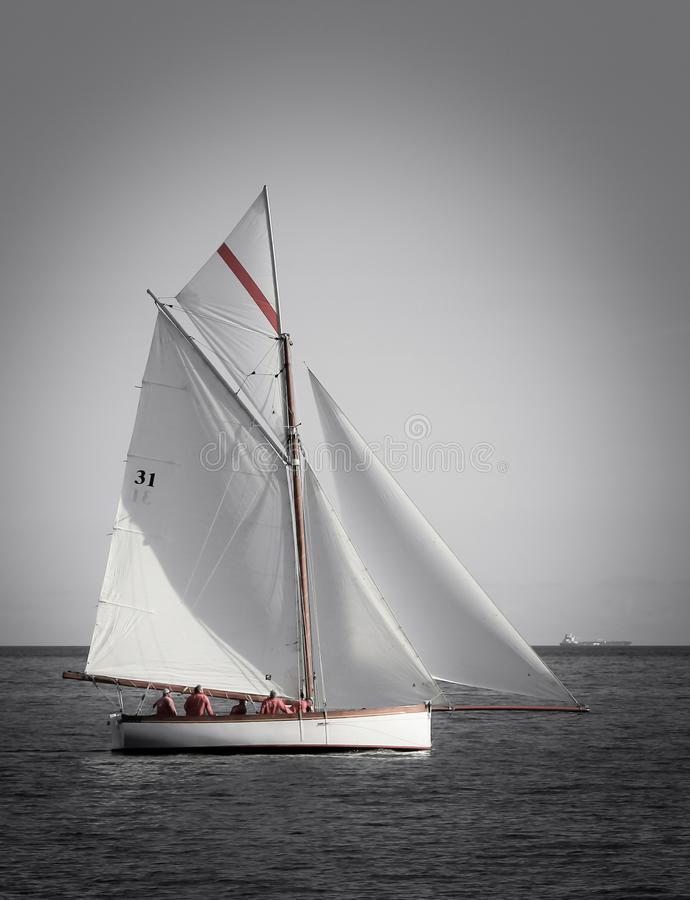 Fal Estuary Sailing, on traditional heritage yacht, Cornwall. Fal Estuary Sailing, on traditional wooden heritage yacht with white sails, Cornwall stock image