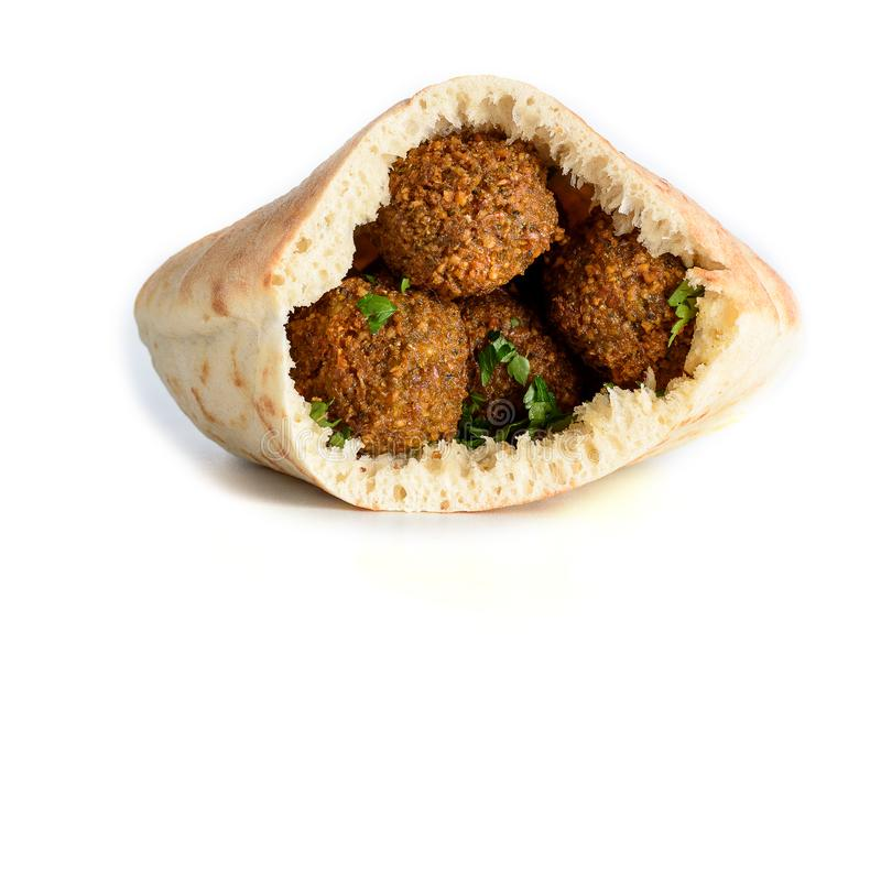 Falafel balls in a pita isolated white background. Falafel is a traditional Middle Eastern food. royalty free stock photography
