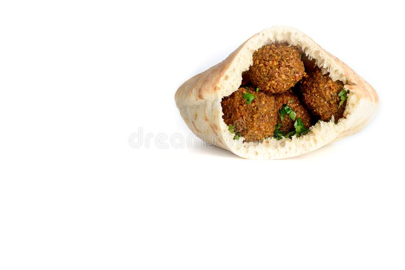 Falafel balls in a pita isolated white background. Falafel is a traditional Middle Eastern food. stock photo