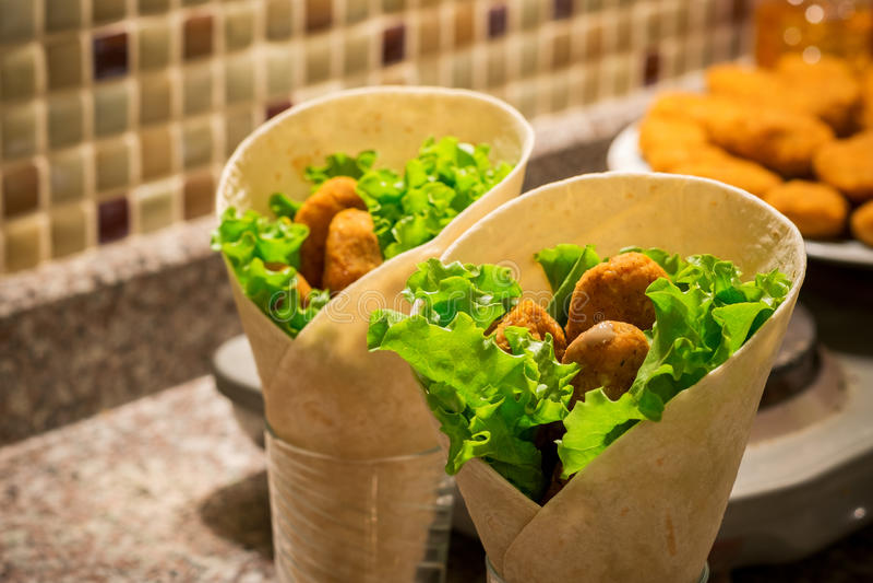 Falafel and fresh salad in pita bread with tahini sauce. stock photos