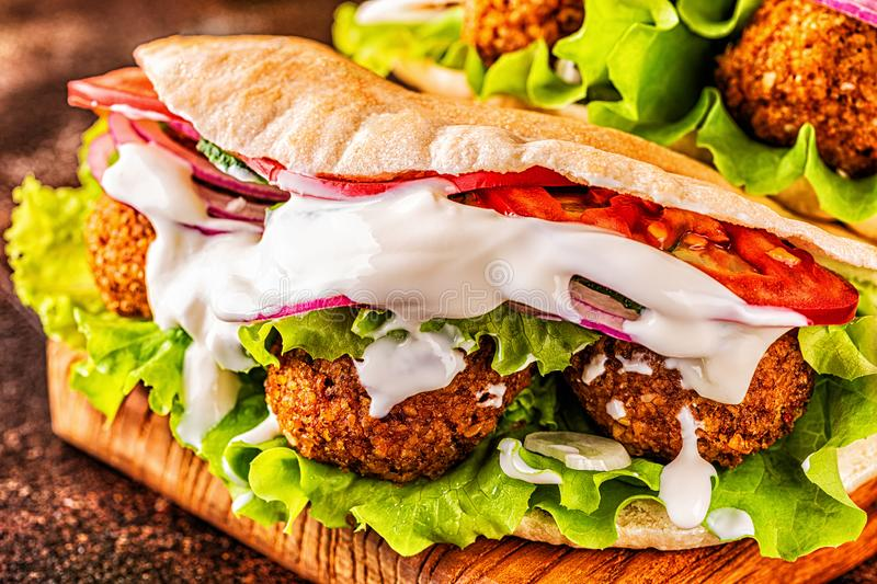 Falafel and fresh vegetables in pita bread stock image