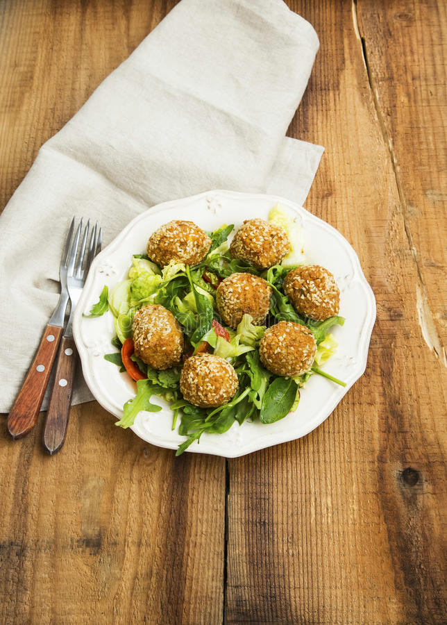 Falafel.Vegan chickpeas balls on a plate with fresh salad on woo stock images