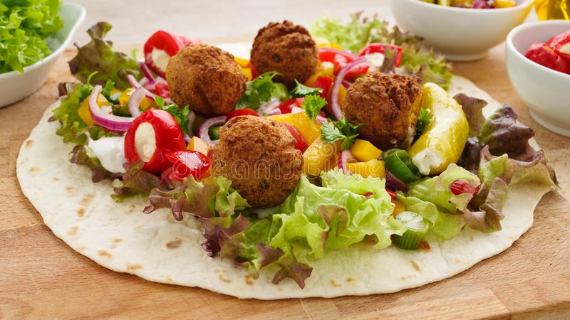 Falafel wrap with veggies. Fresh falafel wrap with veggies, ready to roll royalty free stock photography