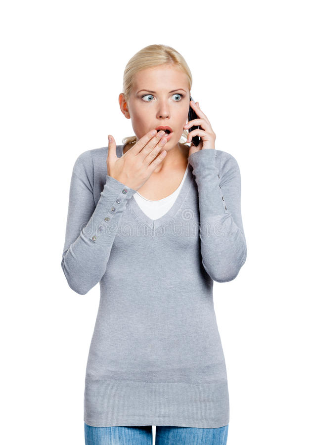 Discurso na mulher chocada telefone imagem de stock royalty free