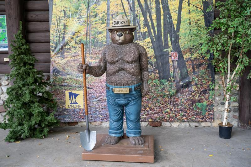 Falcon Heights, MN - August 25, 2019: Smokey the Bear statue at the Minnesota DNR Department of Natural Resources booth at the stock photos
