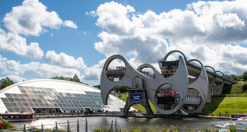 The Falkirk wheel. Falkirk, United Kingdom - August 09 2018: The Falkirk Wheel mechanical canal lift connecting the Union Canal to the Forth and Clyde Canal royalty free stock photo