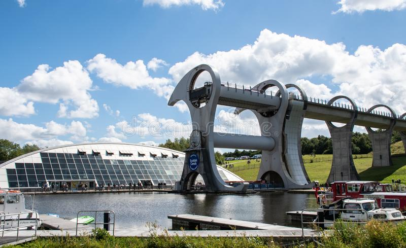 The Falkirk wheel. Falkirk, United Kingdom - August 09 2018: The Falkirk Wheel mechanical canal lift connecting the Union Canal to the Forth and Clyde Canal stock image