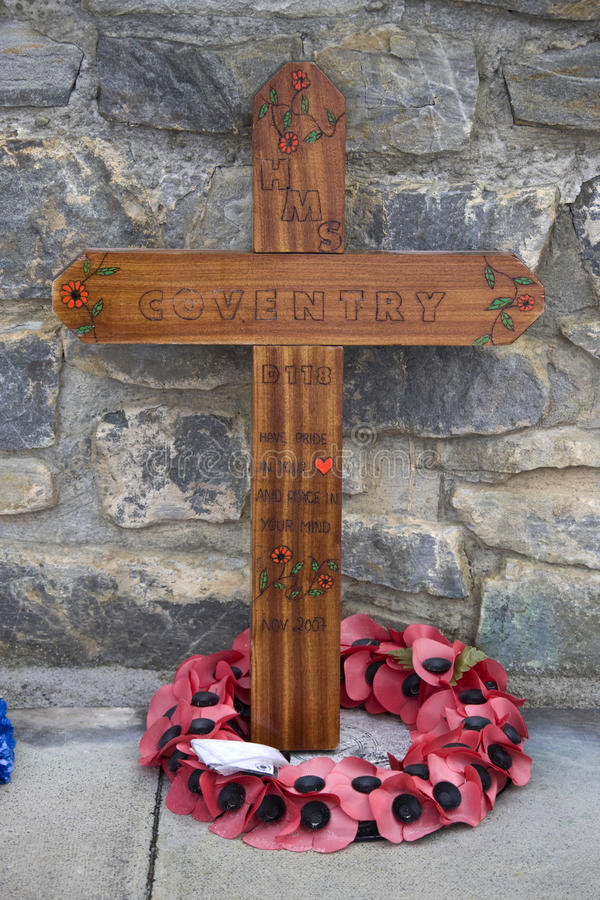 Falklands War Memorial - Falkland Islands. A simple cross in memory of HMS Coventry laid at the Falklands War Memorial in Port Stanley in The Falkland Islands royalty free stock photography