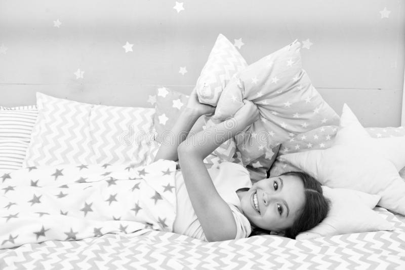 Fall asleep as fast as possible. Fall asleep faster and sleep better. Healthy sleep. Sweet dreams. Girl happy child lay. Bed pillow and blanket bedroom. Lullaby stock image