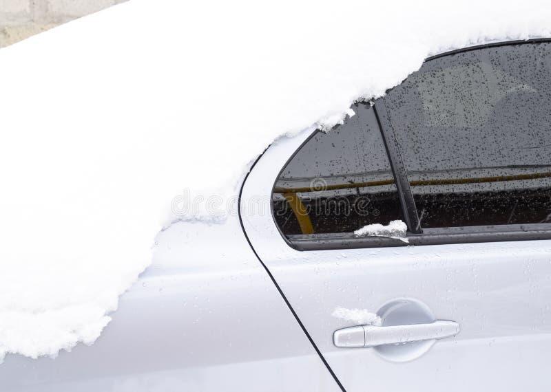 Fall asleep wet snow car. Snowfall of wet snow. Snow lying on the car.  stock photos