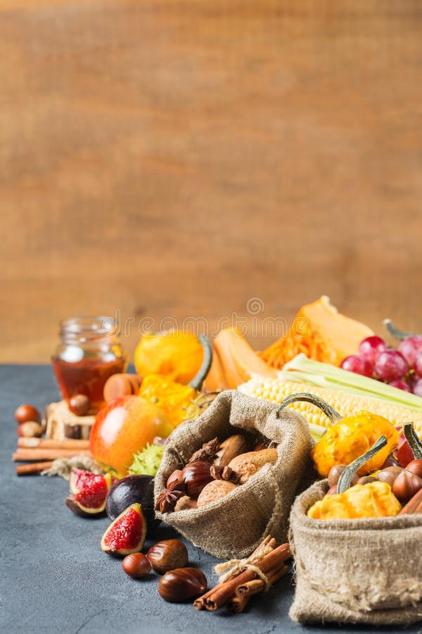 Fall autumn harvest thanksgiving background with pumpkin apple chestnut corn royalty free stock images