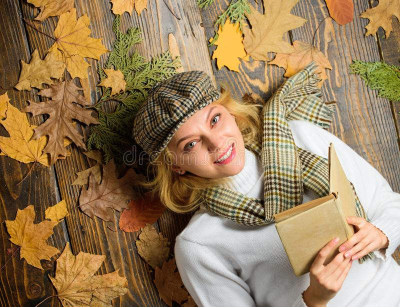 Fall and autumn season. Woman lady in checkered hat and scarf read book. She likes detective genre. Girl in vintage stock photos