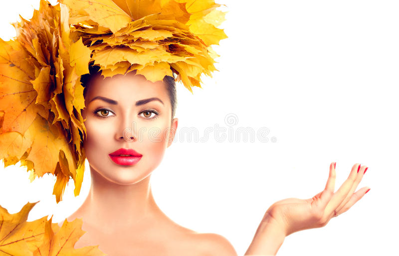 Fall. Beauty model girl with autumn bright leaves hairstyle stock photography