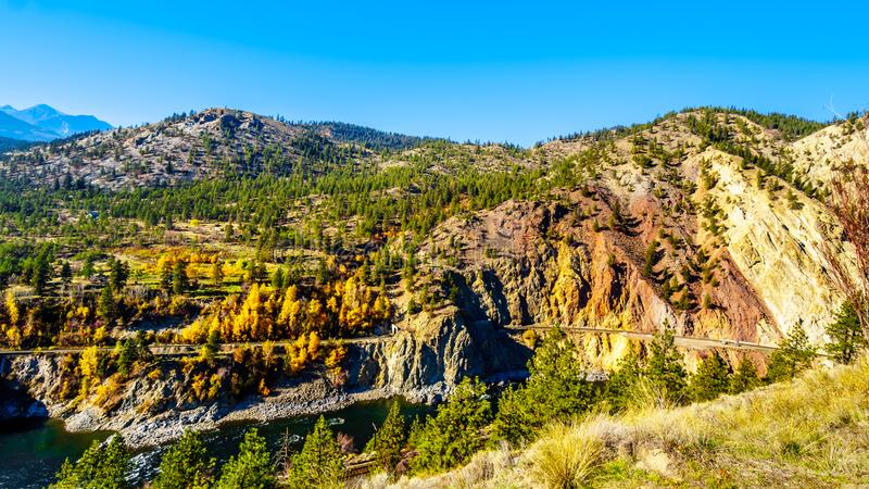 Fall colors along the Thompson River in BC Canada. Fall colors and colorful rocks along the Thompson River at White Canyon near Skihist Provincial Park along the royalty free stock images