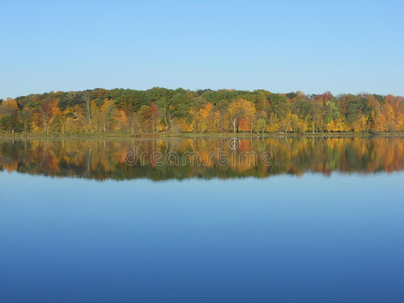 Fall colors on lake royalty free stock photo