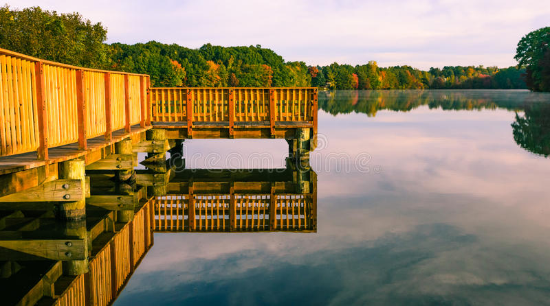 Fall colors reflect on lake pond royalty free stock photos