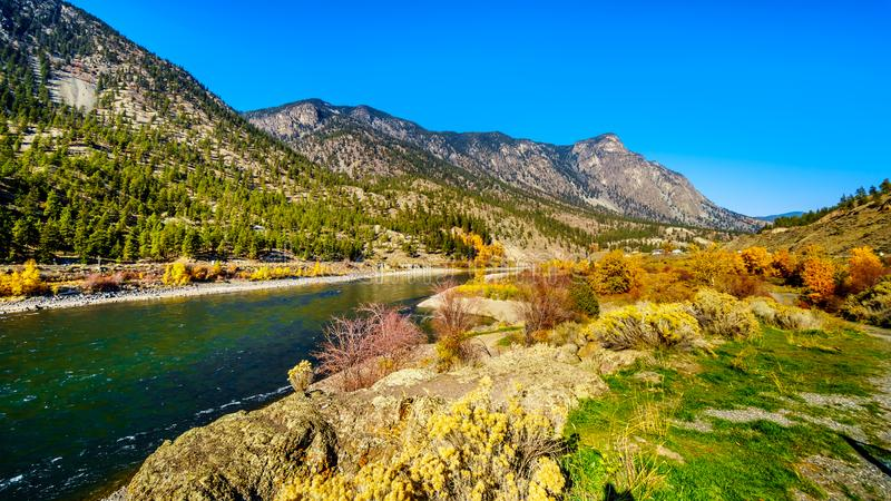 Fall colors surrounding the Thompson River at Goldpan Provincial Park on the Fraser Canyon route of the Trans Canada Highway, High royalty free stock image