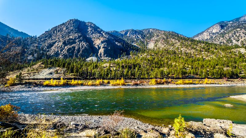 Fall colors by the Thompson River in BC Canada stock photography
