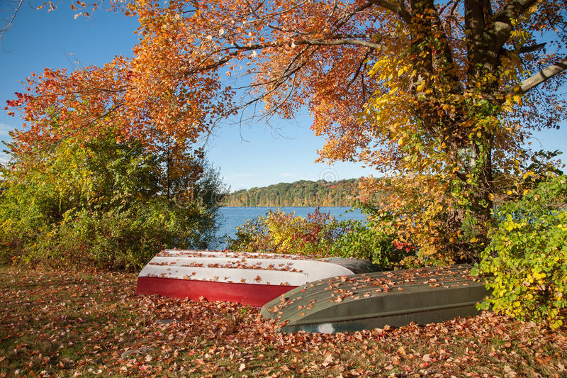 Fall Colors. Two unused row boats next to the lake in Putnam County, NY royalty free stock photo