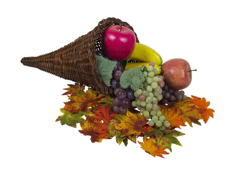 Fall Cornucopia with Colorful Fruit and Leaves. Wicker horn cornucopia which is symbolic for plentiful abundance with colorful fruit and leaves - path included royalty free stock photos