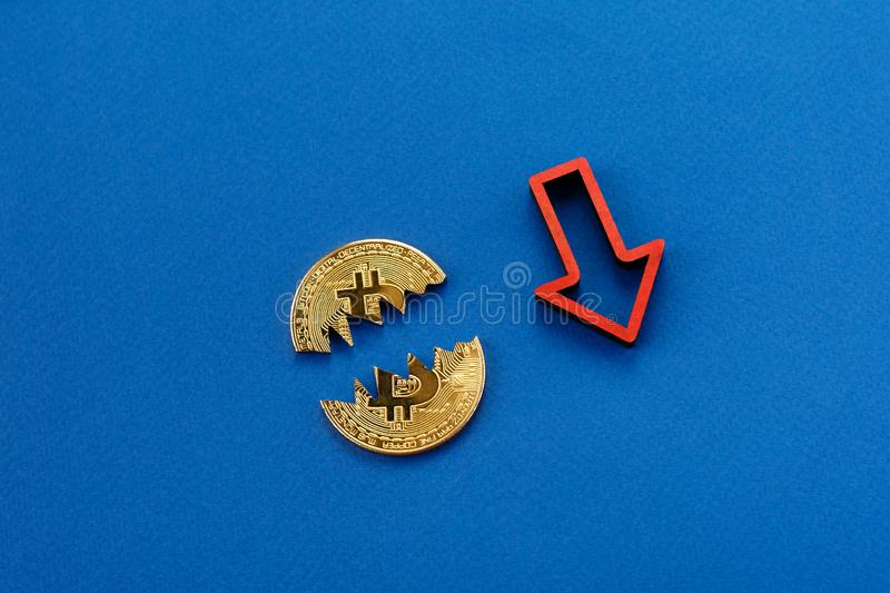 Fall in the cost of bitcoin. Bitcoin and red arrow down. royalty free stock photos