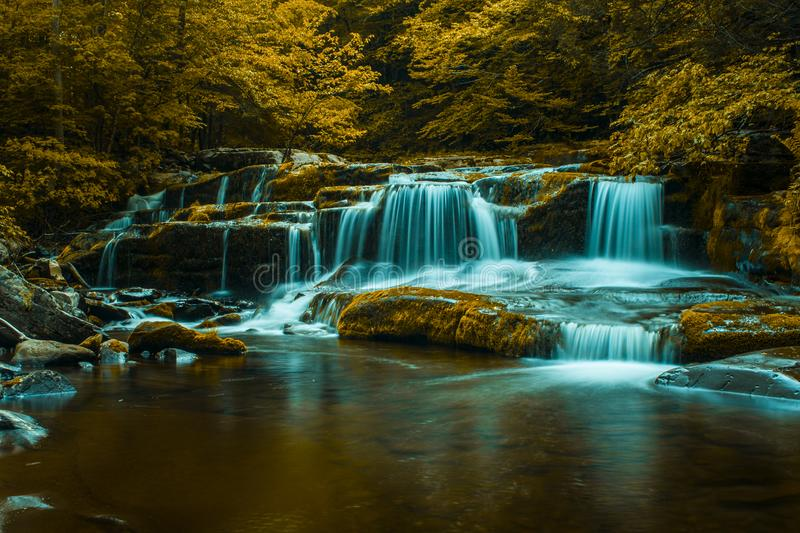Fall in the creek. Water, hunter, mountain, flowing, longexposure royalty free stock images