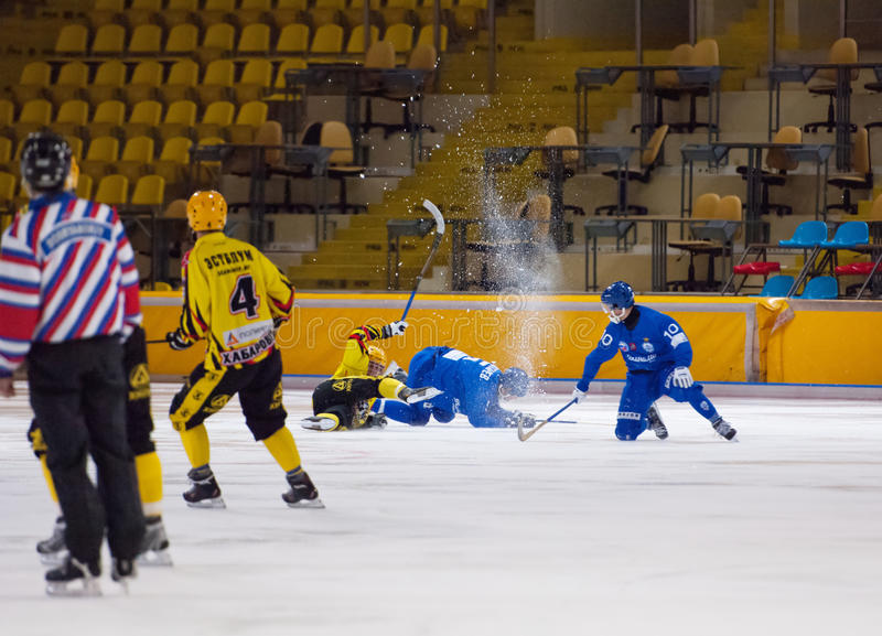 Fall down catching a puck royalty free stock photo