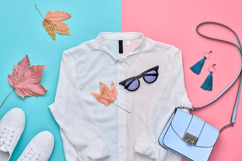 Autumn Fashion Clothes Outfit Flat lay. Maple Leaf. Fall fashion autumn Flat lay. Trendy shirt, Stylish handbag, glamour sunglasses. Creative Woman Clothes stock photography