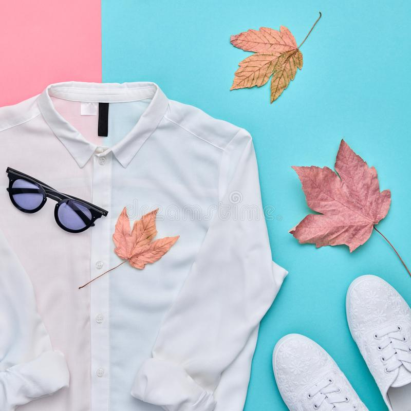 Autumn Fashion Clothes Outfit Flat lay. Maple Leaf. Fall fashion autumn Flat lay. Trendy shirt, Stylish sneakers shoes, glamour sunglasses. Creative Woman stock images