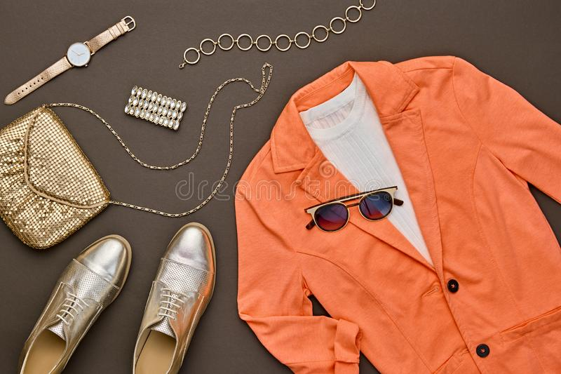 Autumn Fashion Clothes Flat lay, Leaf. Fall Outfit. Fall fashion Clothes Accessories Outfit. Autumn mood, creative Flat lay. Trendy orange jacket, Stylish gold royalty free stock photo