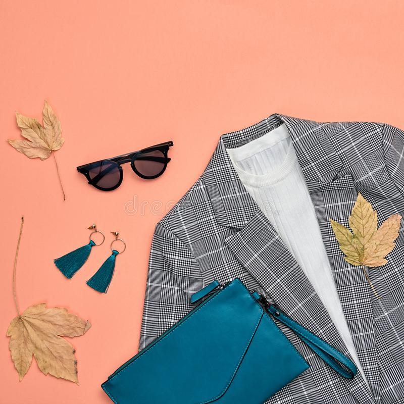 Autumn Fashion Clothes Flat lay, Leaf. Fall Outfit. Fall fashion Clothes Accessories Outfit, Maple Leaf. Autumn creative minimal Flat lay. Trendy coral jacket royalty free stock images