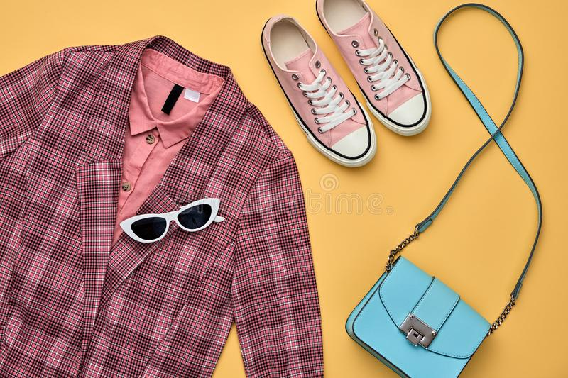 Autumn Fashion Clothes Flat lay, Leaf. Fall Outfit. Fall fashion Clothes Accessories Outfit, Maple Leaf. Autumn creative minimal Flat lay. Trendy pink jacket royalty free stock photo
