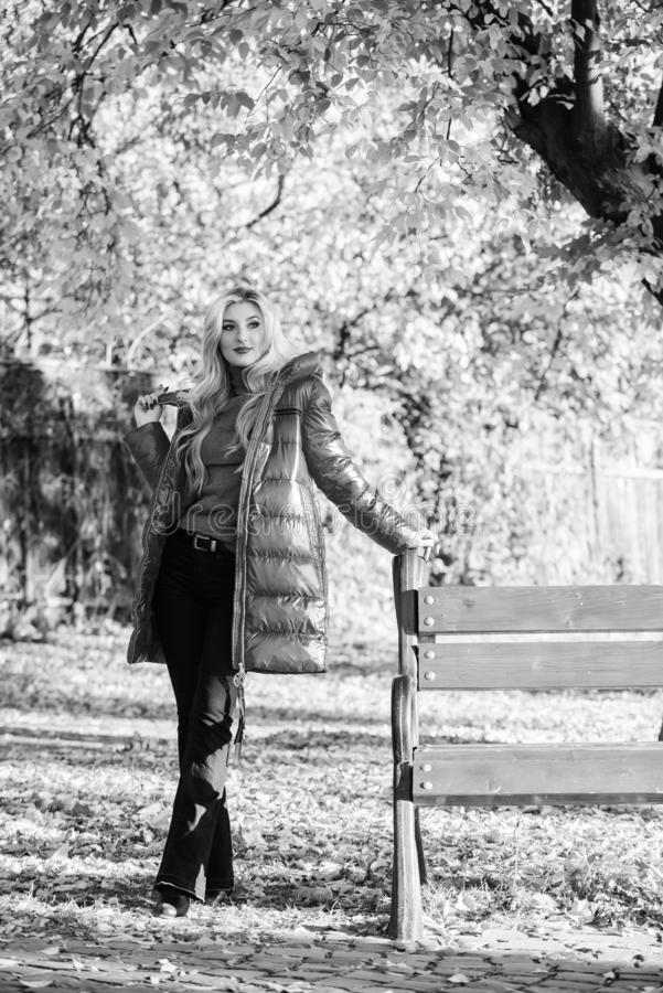 Fall fashion concept. Lady attractive fashionista posing in jacket. Jacket for fall season concept. Woman fashionable. Blonde with makeup stand in autumnal park stock image