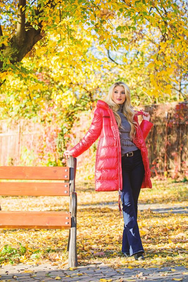 Fall fashion concept. Lady attractive fashionista posing in jacket. Jacket for fall season concept. Woman fashionable. Blonde with makeup stand in autumnal park royalty free stock image