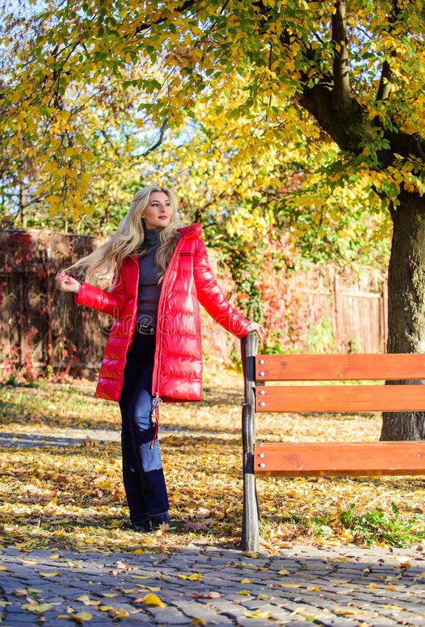 Fall fashion concept. Lady attractive fashionista posing in jacket. Woman fashionable blonde with makeup stand in. Autumnal park. Jacket for fall season concept royalty free stock image